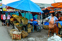 Indonesia, Sumatra. Parapat. The market in Parapat is located close to the harbour where the ferries to Samosir depart. Notice the pregnant, smoking woman.