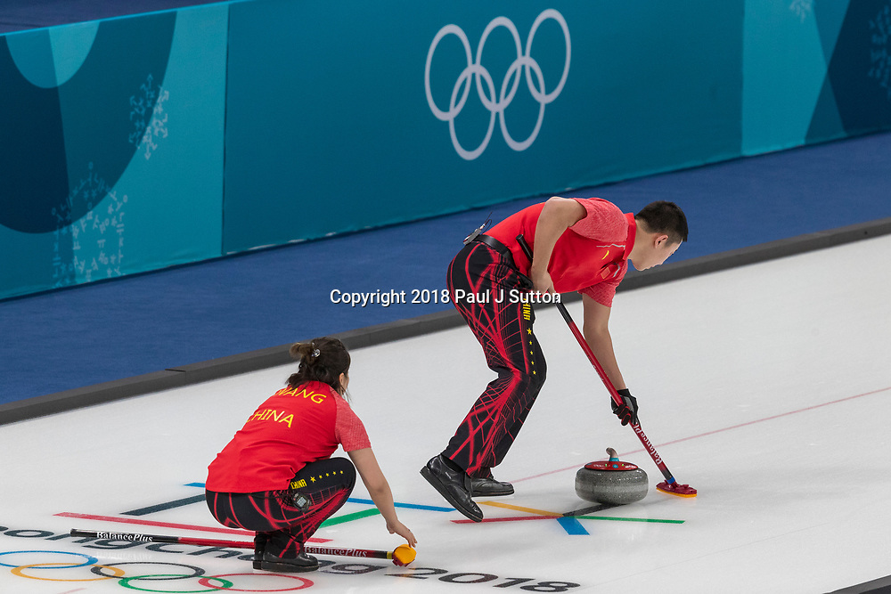 Ba Dexin and Wang Rui (CHN) competing in the Mixed Doubles Curling round robin at the Olympic Winter Games PyeongChang 2018
