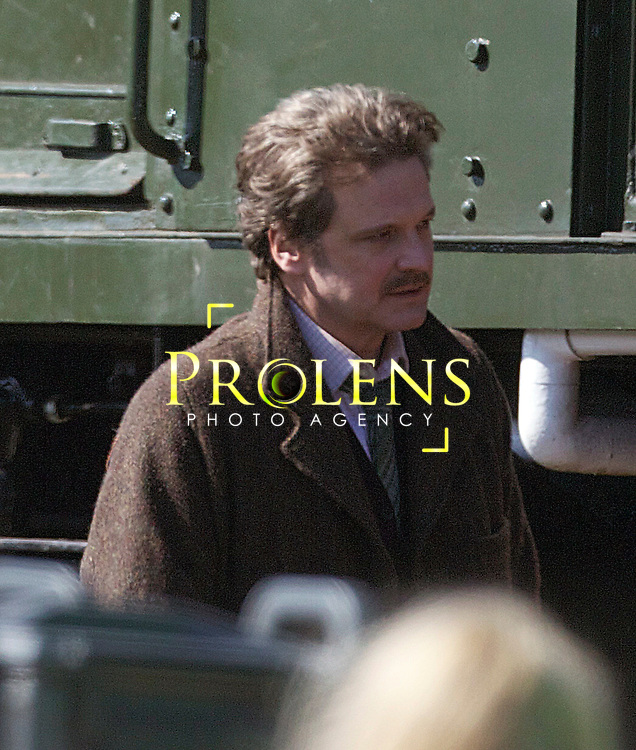 """Filming of The Railway Man On Set with Nicole Kidman and Colin Firth..03-05-12... Oscar winner Colin Firth on the Set in Bo'Ness, Scotland of his latest Movie The Railway Man Staring Nicole Kidman,  jeremy Irvine and Stellan Skarsgard. The film is about A victim from World War II's """"Death Railway"""" sets out to find those responsible for his torture. A true story....At Bo'ness Steam train museum , West lothian, Scotland..Thursday 3rd May 2012.Picture Mark Davison/ Prolens Photo Agency / PLPA"""