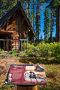 Interpretive sign and log cabin at Tallac Historic Site, Lake Tahoe, California USA