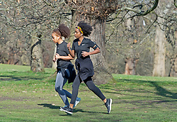 © Licensed to London News Pictures 09/03/2021. Greenwich, UK. Two woman keeping fit with a run. People out and about during a third national Coronavirus lockdown and making the most of the sunny weather in Greenwich Park, London. The Met Office has predicted two days of strong winds and rain this week. Photo credit:Grant Falvey/LNP