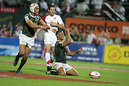 Action from the 2008-2009 opening event in the IRB World sevens series, the Emirates Airline Dubai Sevens 2008 tournament at the new Sevens Stadium in Dubai on 28th/29th November 2008. The cup final between South Africa and England. South Africa's Ryno Benjamin celebrates his try in the dying seconds to clinch a 19-12 win.