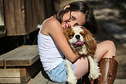 Young girl of 12 with her pet dog