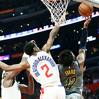 LOS ANGELES, CA - MAR 19: Tyreke Evans (12) of the Indiana Pacers goes for the reverse layup past Shai Gilgeous-Alexander (2) of the LA Clippers during a game on March 19, 2019 at the Staples Center, in Los Angeles, California.