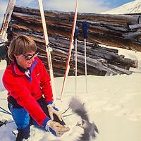 A skier feeds a bird while cross county skiing near Copper Mountain Ski Area, Colorado.