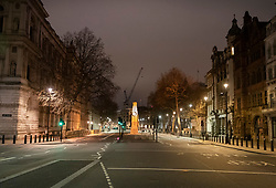© Licensed to London News Pictures. 31/12/2018. London, UK. Whitehall is completely empty of traffic before the crowds arrive to celebrate New Year's Eve in central London.  Over 100,000 people are attending London's ticketed fireworks display on the banks of the River Thames for New Year's Eve tonight. Photo credit: Peter Macdiarmid/LNP