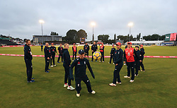 The England Women's team play football on the fringe with covers on the pitch as play is delayed due to rain during the Vitality International T20 match at The Pattonair County Ground, Derby.