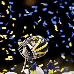 January 3, 2012; New Orleans, LA, USA; Michigan Wolverines cornerback Troy Woolfolk (29) raises his helmet into the confetti following an overtime win over the Virginia Tech Hokies in the Sugar Bowl at the Mercedes-Benz Superdome. Michigan defeated Virginia 23-20 in overtime. Mandatory Credit: Derick E. Hingle-US PRESSWIRE