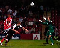 Photo: Ed Godden.<br /> Cheltenham Town v Bristol City. Carling Cup. 22/08/2006.<br /> Scott Brown (2nd left) heads the ball towards the Cheltenham keeper, Shane Higgs.