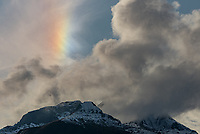 I spotted this bright sundog over a mountain near Grindelwald, Switzerland. It didn't last long.