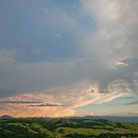 Evening thunderheads tower over Montana's Gallatin Range and Story Hills, near Bozeman.
