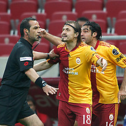 Referee's Bunyamin GEZER (L) and Galatasaray's Ayhan AKMAN (C) during their Turkish superleague soccer derby match Galatasaray between Trabzonspor at the TT Arena in Istanbul Turkey on Sunday, 10 April 2011. Photo by TURKPIX