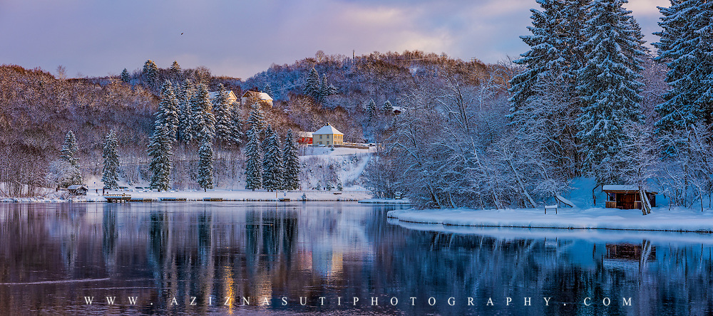 www.aziznasutiphotography.com                                   This picture has been taken after several days of snow in Trondheim. Nidelva River is one of my favourite iconic element in Trondheim