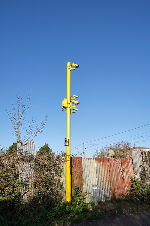 Bright yellow safety enforcement cameras RLSE on one side of a level crossing on the Great Eastern Main Line. A matching set on the other side have been installed to improve safety at the crossing. <br /> Photo by Jonathan J Fussell, COPYRIGHT 2020