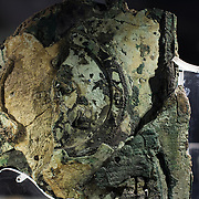 One of the highlights of the National Archaeological Museum in Athens, Greece, the Antikythera Mechanism now has its own dedicated exhibit gallery in which all of its fragments are on display. Believed to date to somewhere around 100 BC to 205 BC, it was found amongst a large cache of statues, coins, and other artefacts on a sunken shipwreck discovered in 1900 by sponge divers off the coast of the Greek island of Antikythera. It was badly damaged after such a long time in the salt water, but extensive research in recent decades has resulted in a consensus that it is a kind of astronomical analog computer as well as some modern reconstructions. The back side of Fragment A, the largest surviving piece and the one that contains most of the gears.