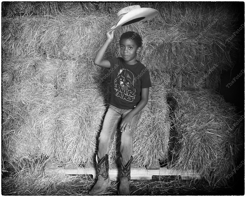FLEMINGTON, NEW JERSY: Jacob tips his hat during a portrait shoot, at a cowboy celebration in Flemington, NJ on Saturday, August 28, 2021.  The celebration featured team sorting, horseback riding and a cookout.    (Brian Branch-Price/TheFotoDesk)
