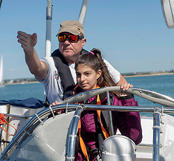 Simon Le Bon, with Margarita Xenitopoulou 14 , on a 72 foot Challenger yacht in the Solent off Portsmouth where he announced his partnership with the Tall Ships Youth Trust .