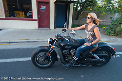 Krystal Hess rides the Indian Scout she customized at her Ricochet Customs Texas shop in the big parade to Downtown Austin during the 2016 ROT (Republic of Texas Rally). Austin, TX, USA. Friday, June 10, 2016.  Photography ©2016 Michael Lichter.