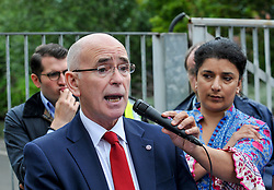 Pictured: Jim Strang, Chief Executive of Parched Housing Association talks to the demonstrators.<br /> <br /> Protesters gathered outside the main Home Office building in Glasgow to protest at private company SERCO's attempts to evict failed asylum seekers from their homes.<br /> <br /> © Dave Johnston / EEm