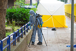© Licensed to London News Pictures 30/07/2021. Greenwich, UK. First crime scene outside Stanton House flats. A police investigation has been launched after a double stabbing in Greenwich, London which has left one man dead and another in a life-threating condition in hospital. A large cordon is in place with police forensic officers working two crime scenes near the Cutty Sark. Photo credit:Grant Falvey/LNP