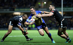 Leeds Rhinos Danny McGuire is tackled by Hull FC's Jake Connor during the Betfred Super League Semi-Final match at the Headingley Carnegie Stadium, Leeds.