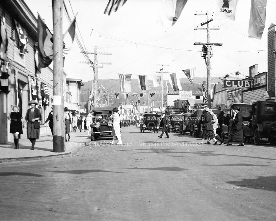 0706-E1.  Broadway looking east from N. Downing St., Seaside. On the right: Strand Theater, Log Cabin Drug Co. 325 Broadway. About 1920.