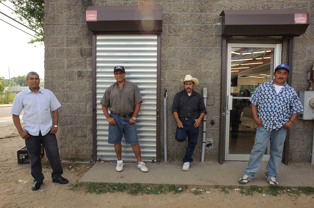 (left to right) Jose Martinez from Honduras, Carlos Alberto Flores from El Salvador, Efrain Castro from El Salvador and Juan Fuentes from El Salvador pose for a portrait as they wait for their clothes to be ready at a Laundromat in Brentwood. (July. 14, 2012)