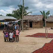 Bernard Kudakpo (36, 2 wives, 6 kids) poses with his mom and children for a photograph. Bernard makes 150cedis a week and tries to save 20cedis every week. Nyatikpo-Battor, North Tongu, V/R. Ghana