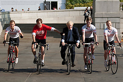 © Licensed to London News Pictures. LONDON, UK  05/07/11. Alastair Campbell, Chairman of Fundraising at Leukaemia and Lymphoma Research, lends the Mayor of London, Boris Johnson, a hand after a bike ridden wobble.  The pair were riding in Trafalgar Square alongside four school boys who are set to cycle from London to Lisbon in aid of the blood cancer charity. Alastair Campbell, L-R Louise Metcalfe (17), Alastair Campbell, Boris Johnson, Archie Gilmour (17, Boris Johnson's godson) and Tom Prebenson (16), for more information see www.beatbloodcancers.org. Please see special instructions for usage rates. Photo credit should read Matt Cetti-Roberts/LNP