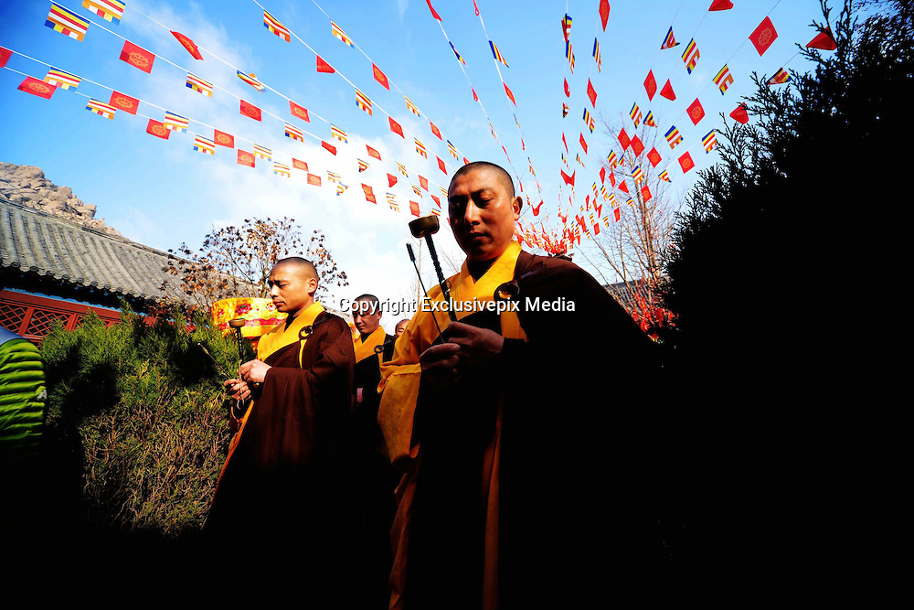QINGDAO, CHINA - MARCH 16: (CHINA OUT) <br /> <br /> Masters Attend Groundbreaking Ceremony For Expansion Of Shimen Temple In Qingdao<br /> <br /> Monks and masters from several other provinces attend a groundbreaking ceremony for the expansion of Shimen Temple on March 16, 2016 in Qingdao, Shandong Province of China. Shimen Temple, located along the north side of Dazhu Mountain in Jiaonan City, got built in the year 1166 and was also known as Yuquan Temple for a spring under a stone in its right door. The expansion involves Buddha halls and pavilions as well as other temples which estimates with 76.9 million Yuan (about 11.8 million USD). <br /> ©Exclusivepix Media