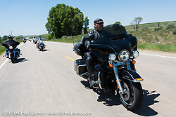 Don Martinez ofAurora, CO and member of the Aurora HOG Chapter on his 2015 Ultra Limited riding from Steamboat Springs, Colorado, to Baggs, Wyoming during the Rocky Mountain Regional HOG Rally, USA. Friday June 9, 2017. Photography ©2017 Michael Lichter.