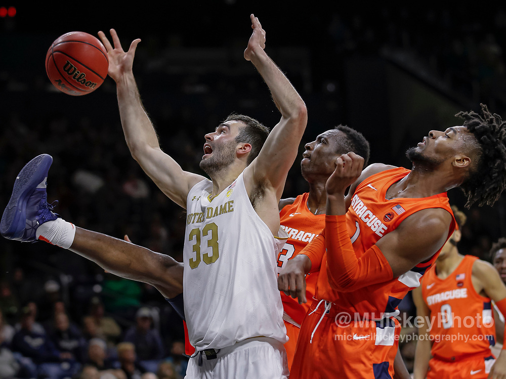 SOUTH BEND, IN - JANUARY 22: John Mooney #33 of the Notre Dame Fighting Irish reaches for the ball against Quincy Guerrier #1 of the Syracuse Orange at Purcell Pavilion on January 22, 2020 in South Bend, Indiana. (Photo by Michael Hickey/Getty Images) *** Local Caption *** John Mooney; Quincy Guerrier