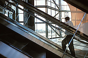 man ascending in escalator