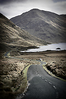 Winding road to Doo Lough Lake and Doo Lough Valley in Ireland