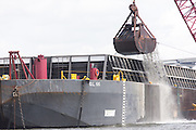 A clamshell dredge excavates the shipping channel in Charleston Harbor June 26, 2013 in Charleston, South Carolina.