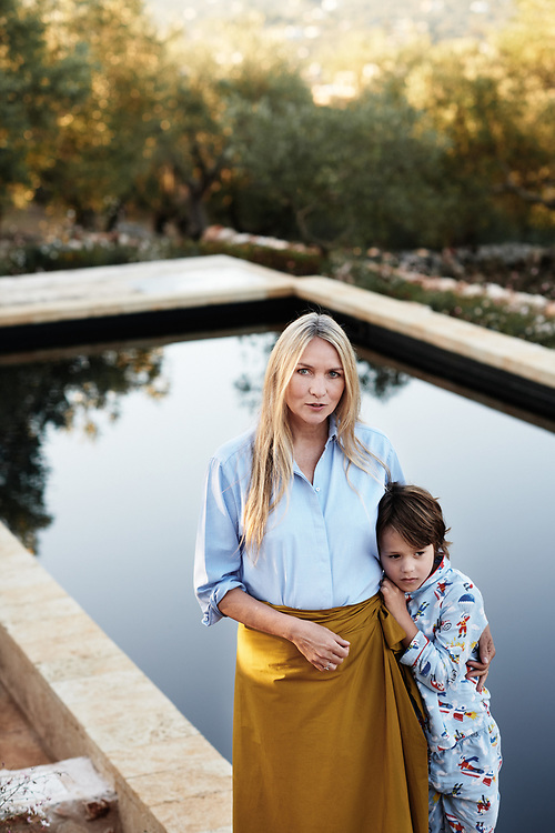 Collette Dinnigan, posing with her son Hunter in her villa's garden. Ostuni, Italia. September 28, 2019.