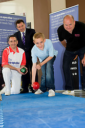 Co-op World Bowls Tour Launch at Ponds Forge Sheffield. ..Top class bowler Simon Skelton with gives a master class to two generations of the Fowler family Dad Chris Fowler and His 12 year old son Danny watched by Co-op Funeral Care National Community Manager John Taylor  3 June 2010 ..Images © Paul David Drabble..