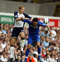 Fotball<br /> England 2005/2006<br /> Foto: SBI/Digitalsport<br /> NORWAY ONLY<br /> <br /> Tottenham v Chelsea<br /> The Barlcays Premiership.<br /> 27/08/2005.<br /> <br /> Michael Dawson of Spurs and Paulo Ferreira of Chelsea compete for an aerial ball