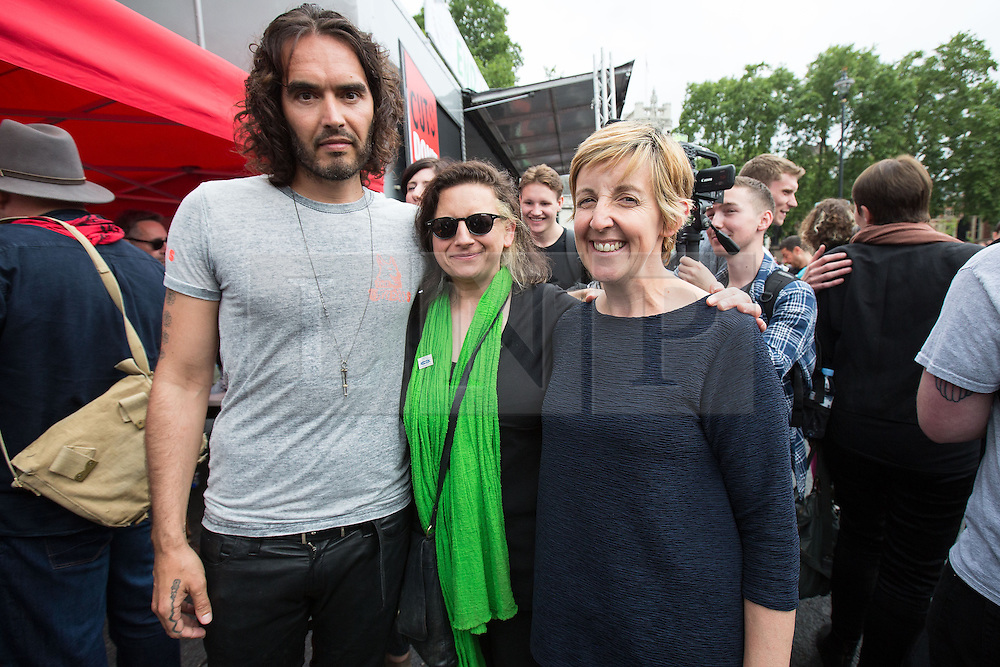 © Licensed to London News Pictures . 20/06/2015 . London , UK . RUSSELL BRAND , ROMAYNE PHOENIX and JULIE HESMONDHALGH in Parliament Square . Tens of thousands of people march from the Bank of England to Parliament , to protest economic austerity in Britain . Photo credit: Joel Goodman/LNP