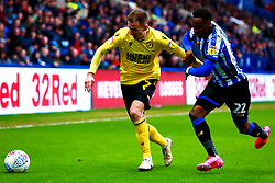 Jed Wallace of Millwall holds off pressure from Moses Odubajo of Sheffield Wednesday - Mandatory by-line: Ryan Crockett/JMP - 01/02/2020 - FOOTBALL - Hillsborough - Sheffield, England - Sheffield Wednesday v Millwall - Sky Bet Championship