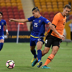 BRISBANE, AUSTRALIA - JANUARY 31: Daniel Bowles of the Roar and Shu Sasaki of Global FC compete for the ball during the second qualifying round of the Asian Champions League match between the Brisbane Roar and Global FC at Suncorp Stadium on January 31, 2017 in Brisbane, Australia. (Photo by Patrick Kearney/Brisbane Roar)