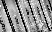 'The Art of a Swimming Race '<br /> The beauty of swimming is the way in which the water, the human form, and the interaction of light with them, can sometimes combine to create images with  an artistic, and sometimes, even surreal quality about them.<br /> The pictures for this essay were taken during the course of my work over a 2 year period, during which time I  covered endless swimming competitions and training sessions ,ranging from olympic to school level races. Covering a swim meet that that was held ,at the right venue,at the right time ,with the right light and permission for the right access I needed, meant that the greatest requirement I needed was the right amount of patience.<br /> <br /> Picture shows...heat 5 of the womens 200 breastroke in the Marine Messe pool at the World Swimming Championships in Fukuoka Japan.<br /> <br /> Date 24th July 2001