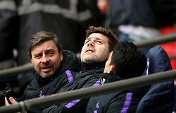 Tottenham Hotspur manager Mauricio Pochettino looks up as snow falls off the arch at the stadium during the Premier League match at Wembley Stadium, London.