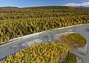 Alaska. Aerial of Alaska Railroad southbound along the Susitna River toward Talkeetna.