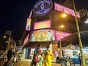 05 JUNE 2015 - KUALA LUMPUR, MALAYSIA: Women walk past a store selling Indian fashions in the Little India section of Kuala Lumpur.     PHOTO BY JACK KURTZ
