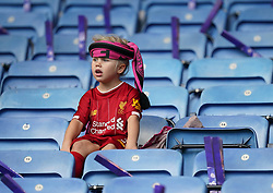 A young fan in a Liverpool shirt in the stands during the FA Women's Super League match at the King Power Stadium, Leicester. Picture date: Sunday October 3, 2021.