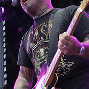 Aaron Lewis of the rock band Staind, sings during his performance at the Rockstar Energy Drink Uproar festival at the 1-800-Ask-Gary amphitheater in Tampa, Florida on Thursday, September 13, 2012. (AP Photo/Alex Menendez)