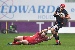 Grant Gilchrist of Edinburgh evades the tackle of Phil Price of Scarlets<br /> <br /> Photographer Craig Thomas/Replay Images<br /> <br /> Guinness PRO14 Round 11 - Scarlets v Edinburgh - Saturday 15th February 2020 - Parc y Scarlets - Llanelli<br /> <br /> World Copyright © Replay Images . All rights reserved. info@replayimages.co.uk - http://replayimages.co.uk