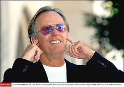 File photo - © Lionel Hahn/ABACA. 51582-2. Los Angeles-CA-USA, October 22 2003. Peter Fonda is honored with the 2,241st star on the Hollywood Walk of Fame in front of the Roosevelt Hotel. Peter Fonda, the star, co-writer and producer of the 1969 cult classic Easy Rider, has died at the age of 79. Peter Fonda was part of a veteran Hollywood family. As well as being the brother of Jane Fonda, he was also the son of actor Henry Fonda, and father to Bridget, also an actor.