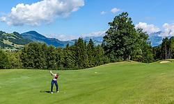 THEMENBILD - Eine Golfspielerin am Golfclub Eichenheim mit der Streif und dem Wilden Kaiser als Bergpanorama, aufgenommen am 04. Juli 2017, Kitzbühel, Österreich // A golfer at the Eichenheim Golfclub with the Streif and the Wilder Kaiser as a mountain panorama at Kitzbühel, Austria on 2017/07/04. EXPA Pictures © 2017, PhotoCredit: EXPA/ Stefan Adelsberger
